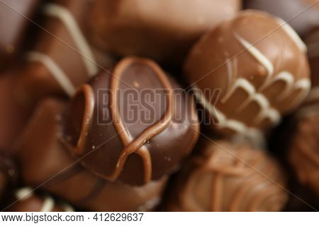 Chocolates Assortment Set.chocolate Sweets.chocolate Pattern. Candy On A Brown Background.dark Milk