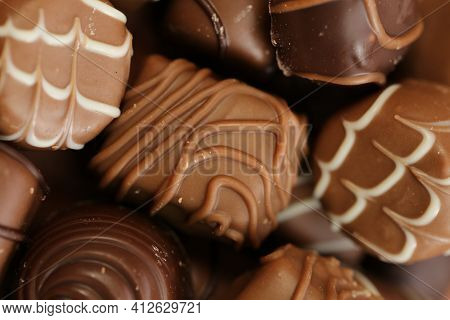 Chocolates Set.chocolate Sweets.chocolate Pattern. Candy Close-up On A Brown Background.dark Milk Ch