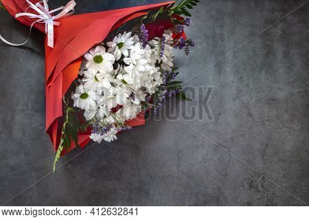 A Beautifully Designed Bouquet Of White Chrysanthemums And Red Roses On A Dark Background. Top View,