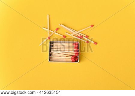Red Matches On The Yellow Background, Close Up.