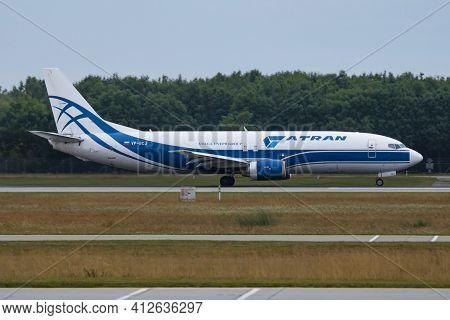 Munich, Germany - July 12, 2017: Volga-dnepr Atran Boeing 737-400 Vp-bcj Cargo Plane Departure And T