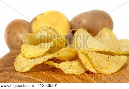 Potato Crisps With Spices And Potatoes On A White Background Potato Chips Close-up.