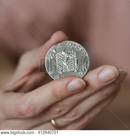 The Person Holds In His Hand A Commemorative Coin Dedicated To The Year Of The Bull