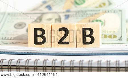 B2B. Business Concept On Cubes And Dollars