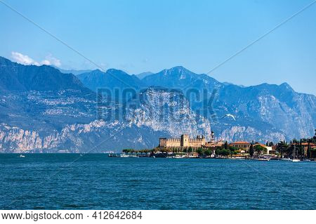 Torri del Benaco resort town on the eastern shore of Lake Garda in Northern Italy. Lake Garda is the largest lake in Italy and a popular holiday location on the edge of the Dolomites