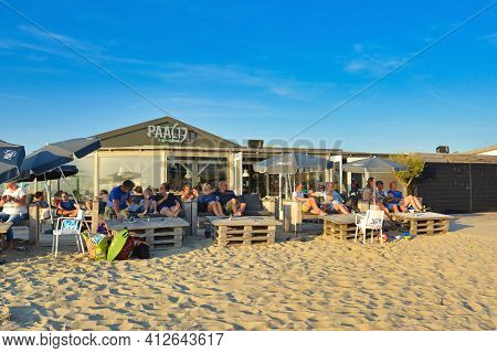 Texel, Netherlands - August 2019: Tourists Relaxing At Beach Parlor Restaurant Called 'paal 17' On I