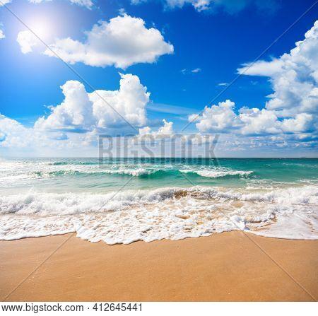 sandy beach and beautiful ocean waves