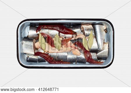 Pieces Of Salted Herring In A Container On A White Background.salted Herring Cut Into Pieces Top Vie
