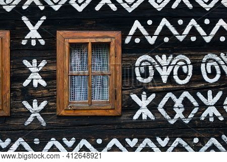 Folklore Decorative Ornamental Painting On Wooden House In Cicmany, Slovakia.