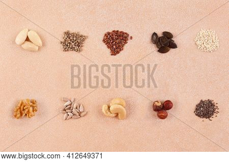 Various Seeds And Nuts On Table. Flax, Hemp, Sunflower, Sesame, Chia, Pumpkin Seeds, And Cashew, Alm