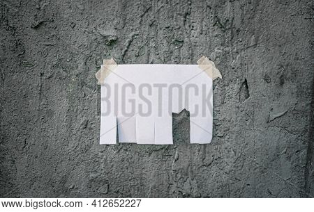 Tear off paper on paint wall. Mock up template. Street paper ad or announcement with tear-off stripes with phone number. Blank design. Copyspace mockup.