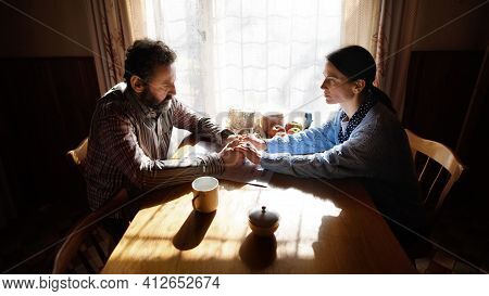 Portrait Of Sad Poor Mature Couple Indoors At Home, Poverty Concept.