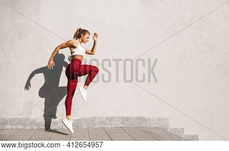 Fit Woman Exercising Outdoors. Healthy Young Female Athlete Doing Fitness Workout