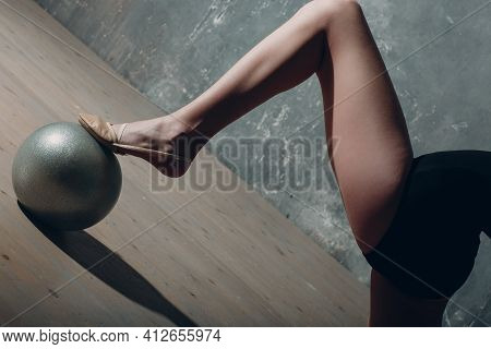Young Girl Professional Gymnast Woman Leg Close Up Rhythmic Gymnastics With Ball At Studio