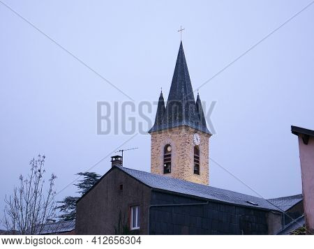 A Bell Tower Of The Church In The South Of France At Saint-pierre-de-trivisy