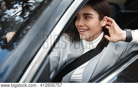 Elegant Female Executive Driving At Work. Businesswoman Sitting In Car With Seatbelt On, Smiling Hap