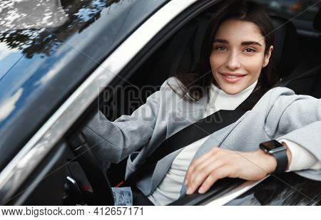 Successful Businesswoman Driving Her Car To Work, Wearing Seatbelt And Formalwear. Attractive Woman