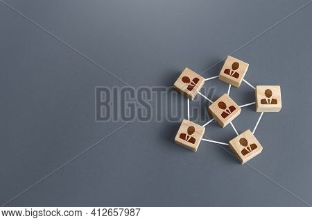 Blocks With Businessmen Connected By Lines Into A Network Team. Participation And Assistance In A Co