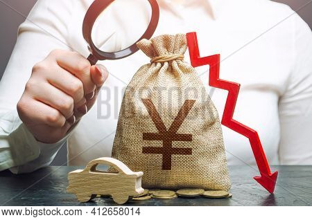 Woman Female Manager Examines A Yen Or Yuan Money Bag With A Red Down Arrow And Automobile. Car Insu