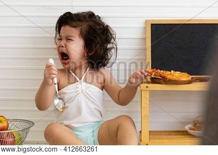 Adorable Cute Hispanic Girl Crying Upset When Finished Eating In The Table. The Baby Cry When They N