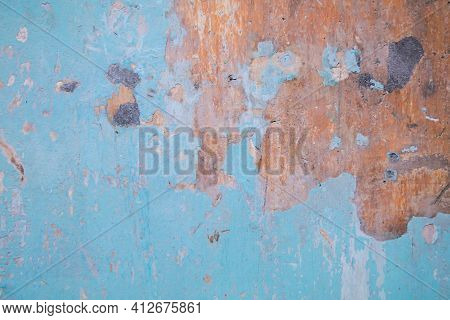 Blue Rusty Grunge Metal Texture Background. An Old Metal Wall Painted With Multi-layered Light Blue