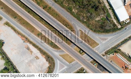 Aerial View Top View Of Highway Road Transport City Junction Road With Car On Intersection Cross Roa