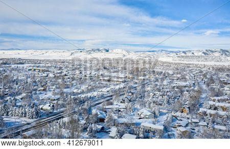 residential area of Fort Collins in northern Colorado after heavy snowstorm, aerial view of late winter or erly spring scenery