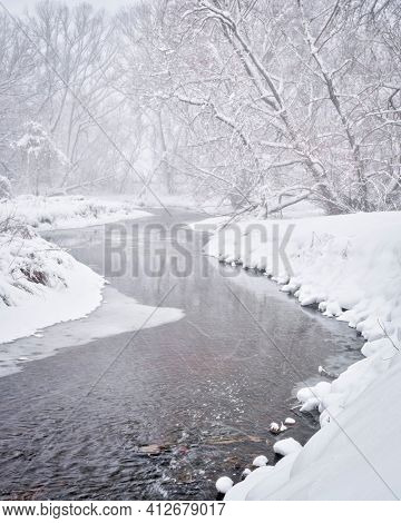 heavy snowstorm over Poudre River in northern Colorado, one of natural areas  in Fort Collins