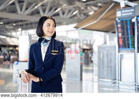 Portrait Of Beautiful Caucasian Flight Attendant Staff Smiling With Confidence Face And Happiness In