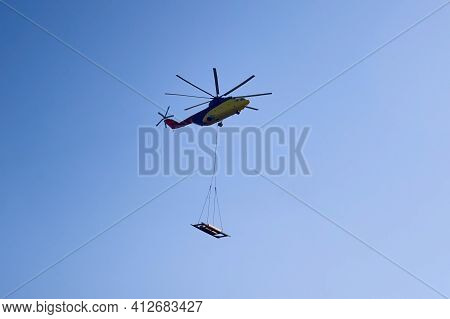 The Worlds Largest Cargo Helicopter Hovers Overhead. Bottom View.the Worlds Largest Cargo Helicopter