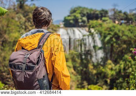 Male Tourist On The Background Of Elephant Waterfall Near Dalat City In Vietnam