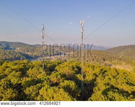 Aerial View Of Mobile Phone Antenna Station Tower In Swiss Alps. Wireless Communication In Mountain