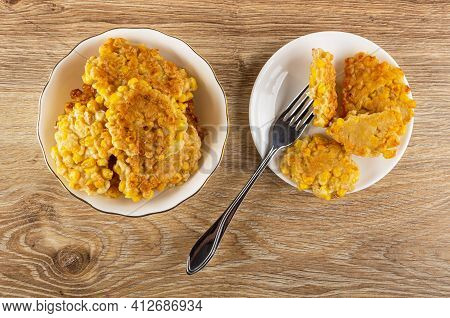Pancakes From Sweet Corn In White Bowl, Half Of Pancake On Fork, Pancakes From Sweet Corn In White S