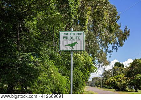 Care For Our Wildlife Signage On Leafy Village Street