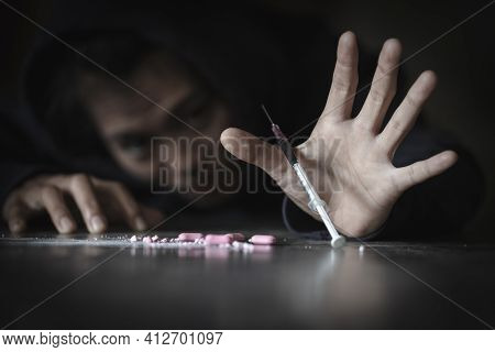 Drug Addict Young Woman With Syringe In Action, Stop Drug Addiction Concept. International Day Again