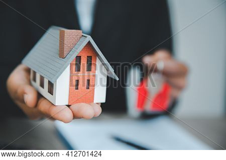 Home Sales Brokers Are Offering Home Sales ,model House On The Front Desk. Real Estate And Residenti