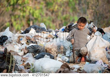 Child Labor. Children Are Forced To Work On Rubbish. Poor Children Collect Garbage. Poverty,  Violen