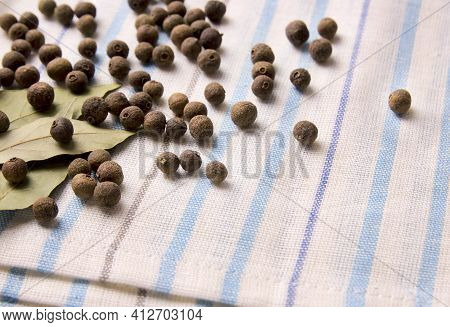 A Bunch Of Allspice On A Kitchen Towel. Jamaican Pepper, Allspice Or Myrtle Pepper
