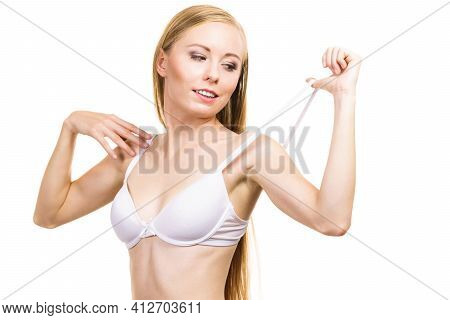 Young Woman Holding Bra Strap