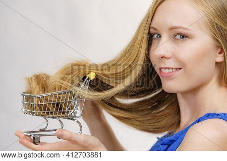Girl With Her Long Hair In Shopping Cart