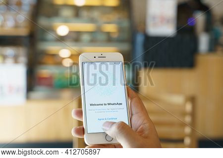 Chiang Mai, Thailand - Feb. 05,2021: Man Holding Apple Iphone 8 With Whatsapp Messenger On The Scree