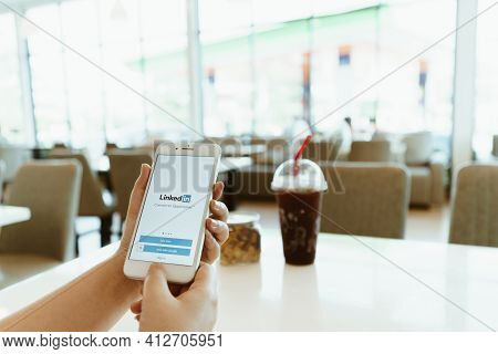 Chiang Mai, Thailand - Sep. 26,2020: Woman Holds Iphone With Linkedin Application On The Screen.link