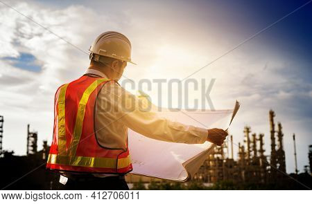 Engineer Worker Concept Working At Oil Refinery. Young Asian Men Worker And Electrician Work Safety