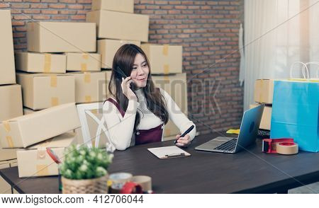 Small Business Startup Entrepreneur Sme Or Freelance Woman Working With Boxes At Home Or Office. Han
