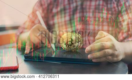 Conceptual Of Business Man Using The Tablet With Bitcoin Exchange Of Trading View Screen And Bitcoin