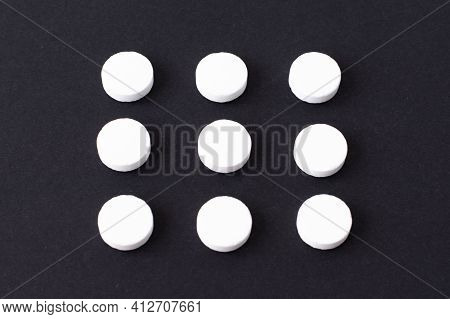 Round White Medical Pills Arranged In Square Order. Pill Splitting.