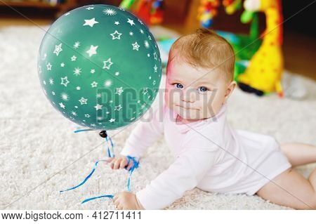 Cute Baby Playing With Red Air Balloon. New Born Child, Little Girl Having Fun, Grabbing And Crawlin
