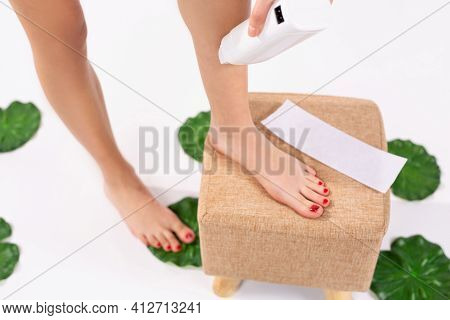Personal Hygiene : Warm Heater For Wax. Fit Young Woman Waxing Her Legs With A Portable Roll-on Depi