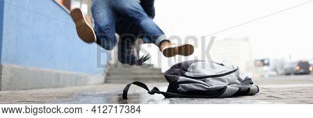 Man In Winter Dress Slip On Sidewalk With Ice Closeup Background