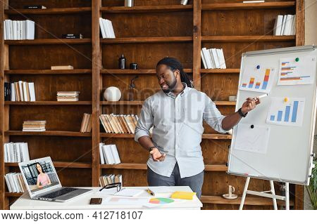 Male Black Entrepreneur Makes Deal Remotely, Shows Financial Graphics Or Discuss Diagrams On Interac